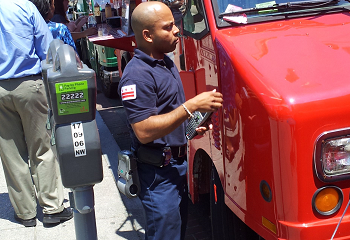 A truck is ticketed during the lunch hour rush.